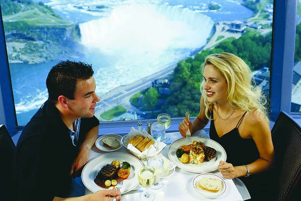 Couple enjoying dinner at a Niagara Falls restaurant